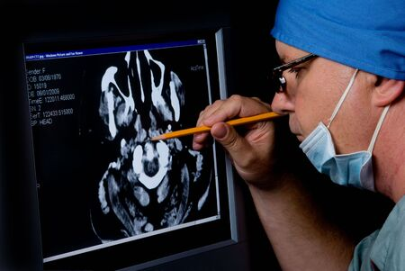 radiologist: A medical doctor examining a CTT Scan.