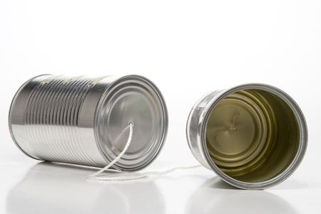 tin: A tin can phone, two cans and a string. Stock Photo