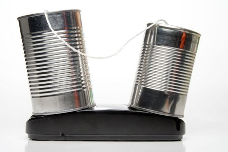 A tin can phone, two cans and a string. Stock Photo - 5397514