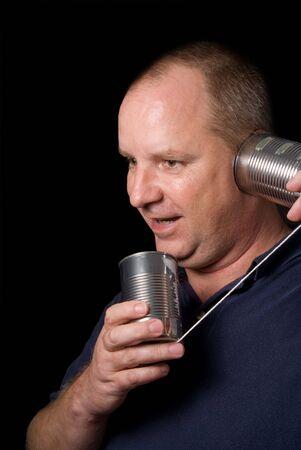 A man talking on a tin can phone. photo