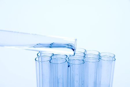 A series of test tubes being used in scientific experiments. Stock Photo - 5424401