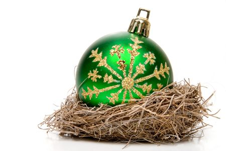 december 25th: A Christmas ornament in a birds nest. Stock Photo