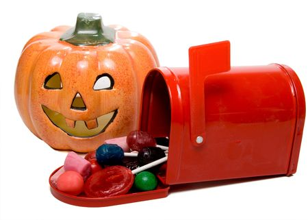 jackolantern: A Jack-O-Lantern and a mailbox full of candy.