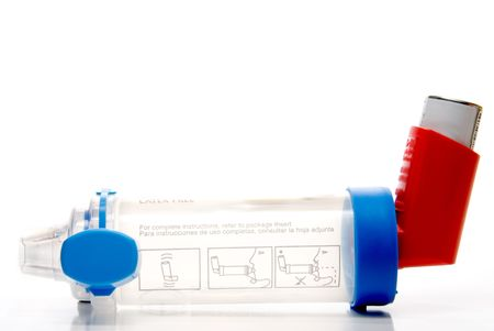 inhaler: A common Asthma Rescue Inhaler Extension Tube. Stock Photo