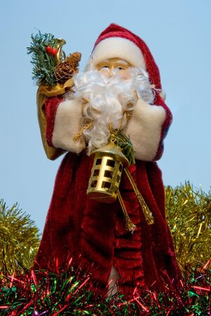 A Santa Claus figure surrounded by Christmas garland. Stock Photo - 5452145