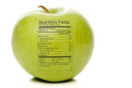 The nutrition facts stamped on an apple. Reklamní fotografie