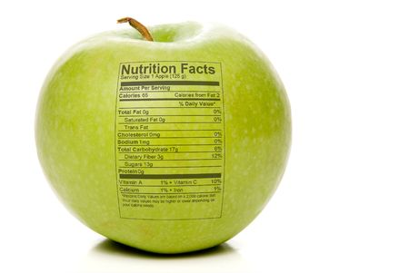 label: The nutrition facts stamped on an apple. Stock Photo