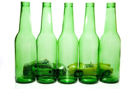 sobriety: Drunk Driving Concept - Car pulled over by police behind beer bottles. Stock Photo