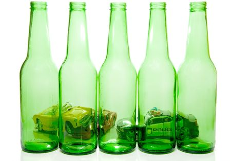 Cars wrecked behind beer bottles - Drunk Driving Concept photo
