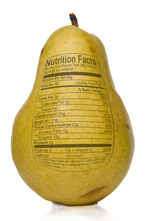 label: Pear Nutrition Facts printed on the skin of a pear. Stock Photo