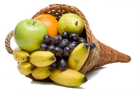 A cornucopia basket filled with delicious fresh fruit. photo