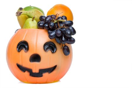 A halloween pumpkin filled with delicious fruit. photo