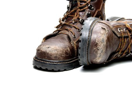 A pair of very worn work boots. Stock Photo