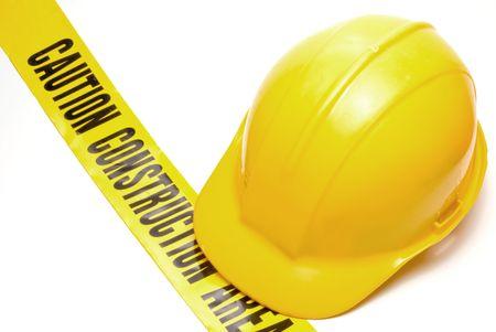 pokrývka hlavy: A Hard Hat on construction area tape.