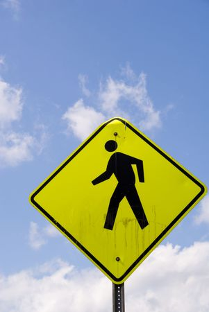walking zone: A large yellow standard Pedestrian Crossing sign.