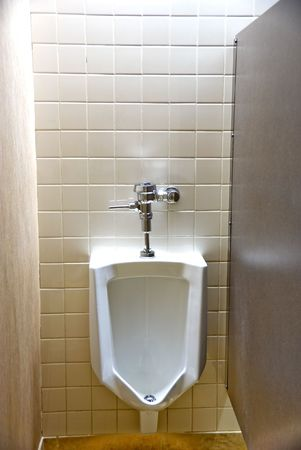 latrine: A Urinal in a mens rest room. Stock Photo