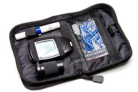 diabetes meter kit: A dibetics medical insulin kit with glucometer. Stock Photo