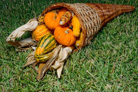 A tradition fall harvest cornucopia with fresh produce. photo