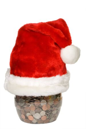 A Santa hat on a coin jar. photo