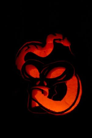 jackolantern: A Jack-O-Lantern lit by a single candle.