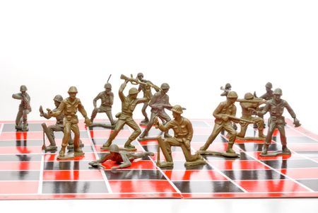 green plastic soldiers: A set of plastic toy soldiers playing chess. Stock Photo