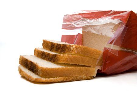 袋に白パンのパン。 写真素材