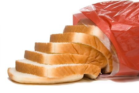 white bread: A loaf of white bread in a bag. Stock Photo
