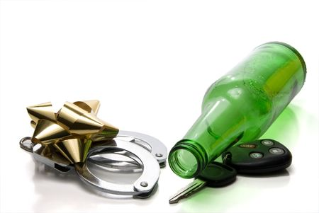 Car keys, beer bottle and a present of handcuffs. photo
