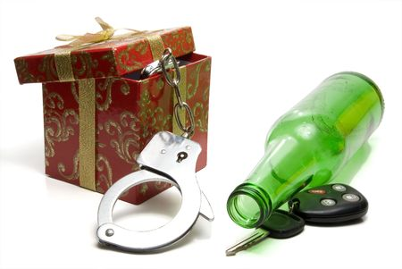 drink responsibly: Car keys, beer bottle and a present of handcuffs.