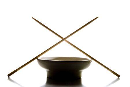 A silhouete of a bowl and chop sticks. Stok Fotoğraf