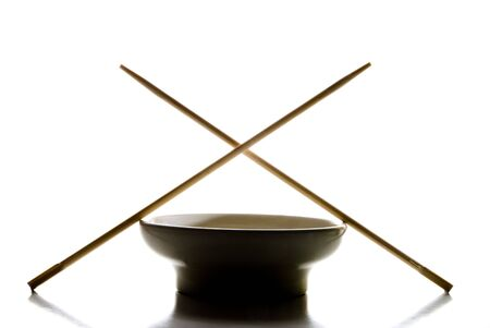 A silhouete of a bowl and chop sticks. Stock Photo - 5965594