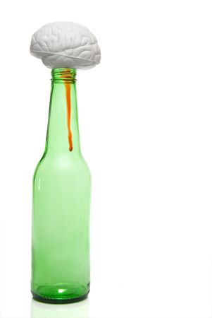A brain on top of a beer bottle. Stock Photo