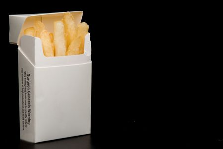 French fries in a cigarette pack - Unhealthy eating photo