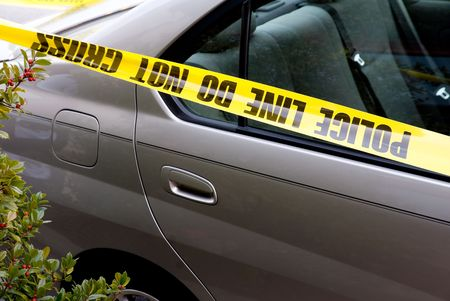 trespass: Police line tape drapped across a car at a crime scene. Stock Photo