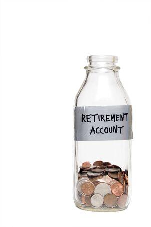 A milk bottle with coins conceptualizing a retirement account. photo