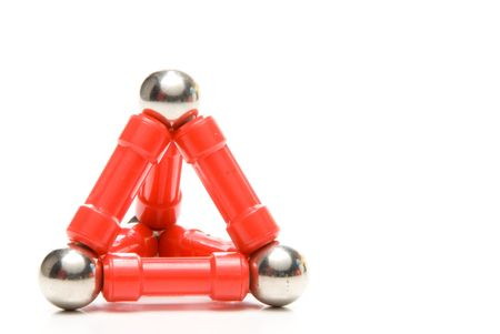 A Toy Pyramid constructed of plastic coated magnets and ball bearings photo