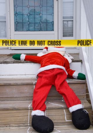 The dead body of Santa Claus at a crime scene. Stock Photo - 6083104