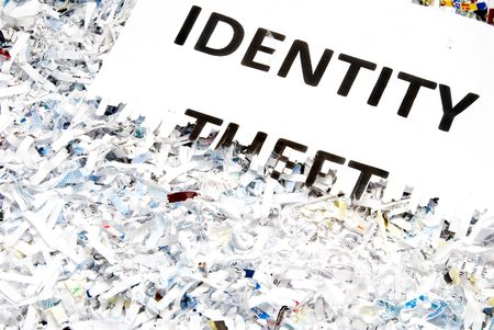 confidentiality: Identity Theft typed on a shredded piece of paper.