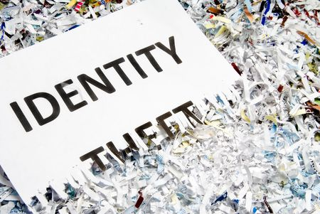 A shredded document with Identity Theft written on it. Stock Photo - 6245435