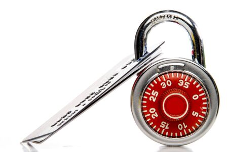 A set of credit cards secured with a padlock. Stock Photo - 6245424