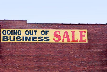bankrupt: A sign advertising a going out of business sale.