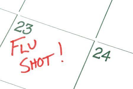 vacunacion: Un aviso de calendario para un shot de la gripe  Foto de archivo