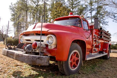 An old vintage antique firetruck ready for action photo