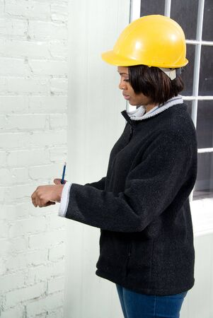 A Female Construction Inspector checking the work on a building Stock Photo - 6505217