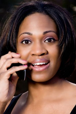 An African American woman talking on the phone photo