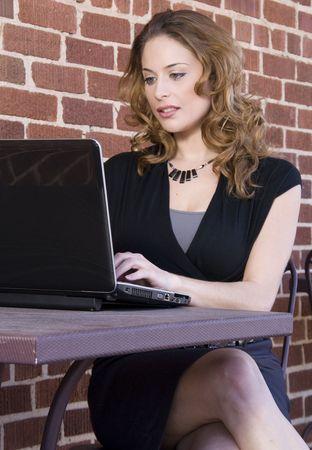 A beautiful computer savvy young woman using a laptop Stock Photo - 6639059