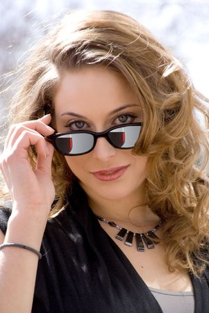 hot chick: A beautiful woman wearing a pair of sunglasses Stock Photo