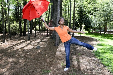 A beautiful young black woman holding an umbrella photo
