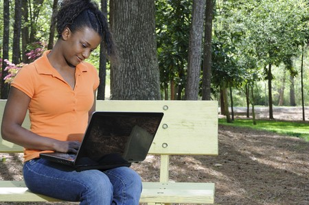 A college student working on a laptop photo