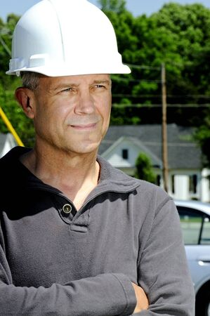 hard: A male construction worker a job site.